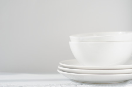white plates and bowls on light table