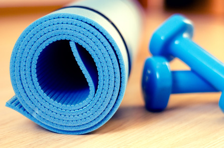 exercise equipment: Mats for fitness classes and dumbbells