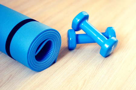 yoga class: Mats for fitness classes and dumbbells