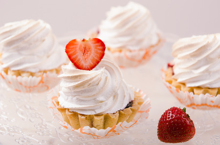 white cream: cake with white cream and fresh strawberries on a stand