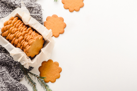 Sweet thin ginger cookies in a gift box on white background on a plaid. Festive pastry. Top view, flat lay. Stock fotó