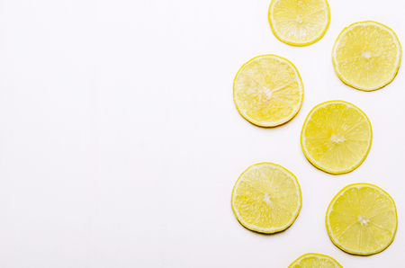 Slices of juicy yellow lemon on white background. Healthy food. Flat Lay, Copy Space.