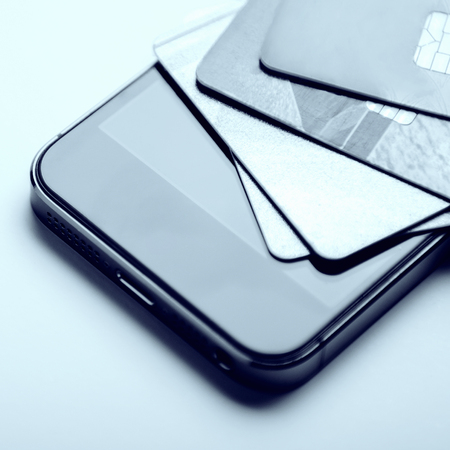 Credit cards on the phone. Online payment, shopping from home. Creative processing