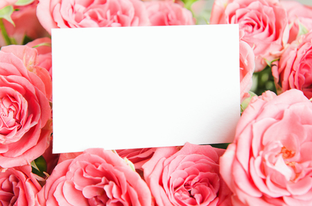 Card for congratulations, inscriptions in a bouquet of pink roses. Mock up, a place for text, copy space. Stock Photo