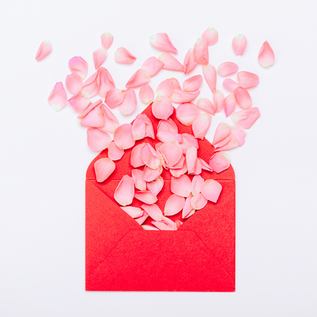 Flower petals in the envelope. A gift for Valentines, Womens Day, Mothers Day. Minimal composition, top view, flat lay. Stock fotó