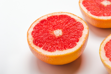 Grapefruit cut in halves on a white background. Useful tropical citrus diet fruit Stock fotó