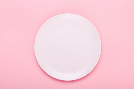 Pink plate on a pink background. Minimal composition. Copy space, top view, flat lay. Stock fotó