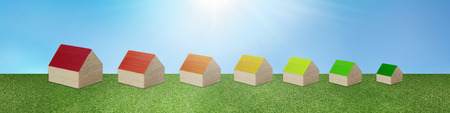 Ecological housing. Concept house heating. Save electricity and gas. Efficient and economical heat. Construction with renewable energy heating. Series of houses forming Energy efficiency scale