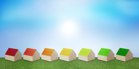 Save electricity and gas. Concept house heating. Ecological housing. Efficient and economical heat. Construction with renewable energy heating. Series of houses forming Energy efficiency scale Stock Photo