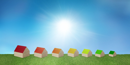 Concept house heating. Construction with renewable energy heating. Save electricity and gas. Ecological housing. Clean environment. Series of houses forming Energy efficiency scale Stock Photo