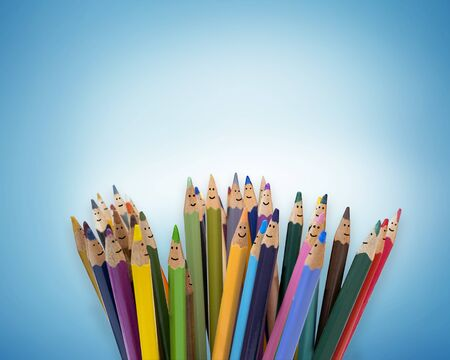 Colored pencils as faces of smiling children. Group of happy children. Concept of friendship and communication children. kindergarten. Community of children with different ethnicity and culture Stock Photo