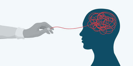 Mental health concept.Hand of a therapist or doctor untangling a tangle in the silhouette head of a patient's side.Psychology and psychiatry.Depression.stress.Mind.Disease.Psychotherapy