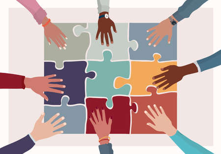 Agreement or affair between a group of colleagues or co-workers.Hands joining puzzle pieces on a table.Diversity People Exchange of ideas. Concept of sharing and exchange.Community