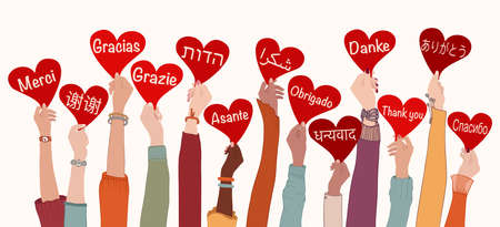 Raised arms and hands of multi-ethnic people from different nations and continents holding heart with text -thank you- in various international languages.Communication.Equality. Allyship