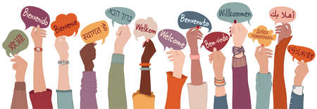 Raised arms and hands of multi-ethnic people from different nations and continents holding speech bubbles with text -Welcome- in various international languages.Communication. Community