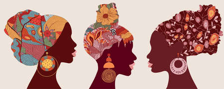 Silhouette faces in profile African or African American women with ethnic or tribal hair decorations and with large earrings. African culture. Racial equality concept