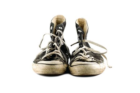 Old grungy sneakers isolated  on white background Stock Photo