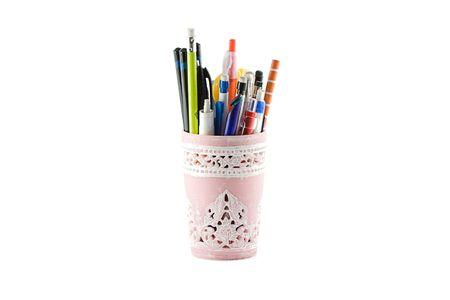 Pencils in a holder isolated on white background Stock Photo - 2614392