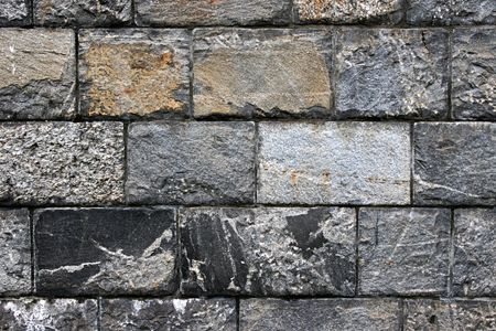 Old grunge stone wall close up photo