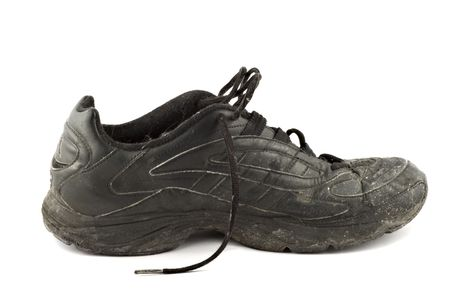Old grungy Running Shoes isolated on white background photo