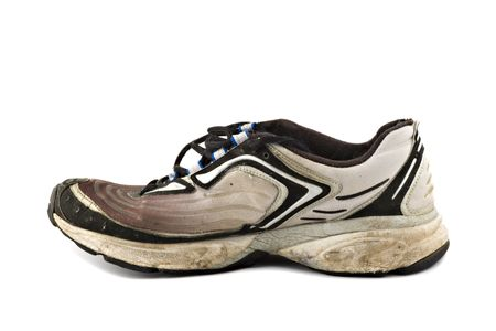 Old grungy Running Shoes isolated on white background