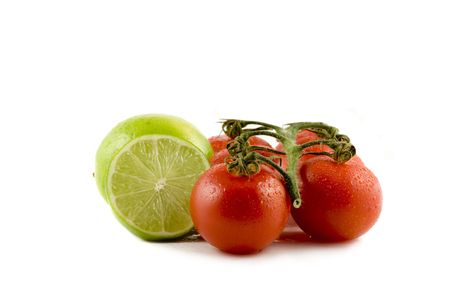 Two limes and two tomatos isolated on white background Stock Photo
