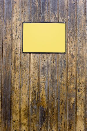 Grungy wood texture whit a yellow sign for background