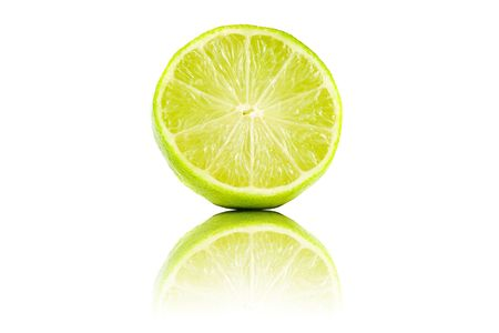 Sliced lime fruit with reflection isolated photo