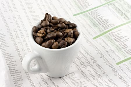 Classic espresso cup on financial pages