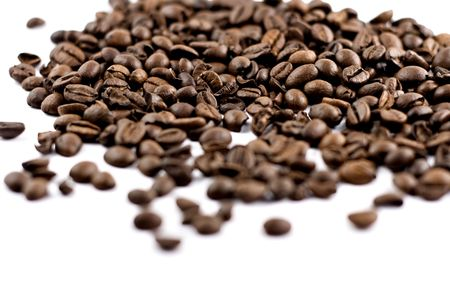 coffee beans isolated on white background, shallow depth of field