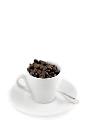 coffee cup with beans isolated on white, Shallow depth of field Stock Photo