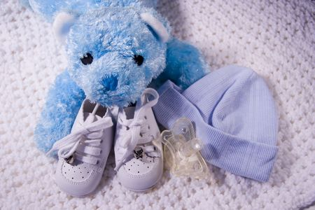Pair of  shoes with Teddy Bear, cap, and Dummy