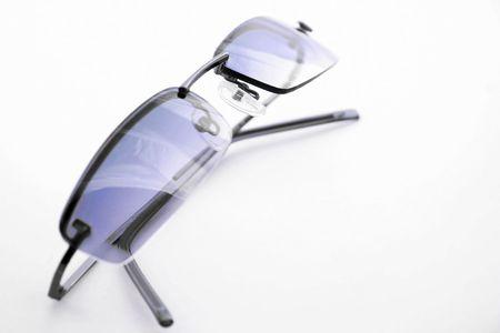 Cool blue sunglasses isoalted on white background photo