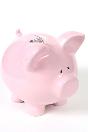 Pink Piggy Bank with Wedding Ring, isoalted on white background