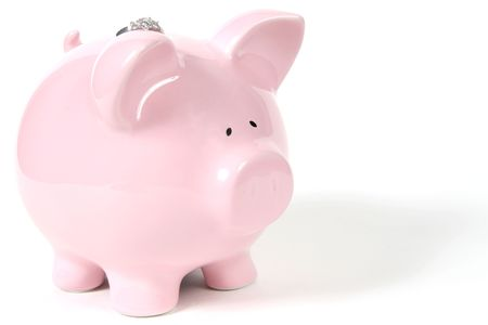 Pink Piggy Bank and Wedding Ring isoalted on white background Stock Photo