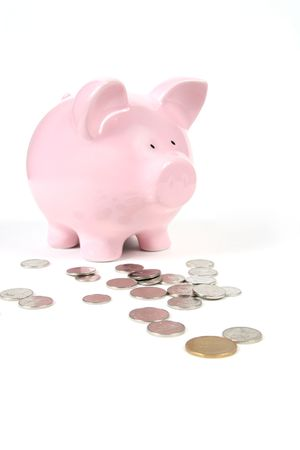 Pink Piggy Bank on isoalted on white background with coins