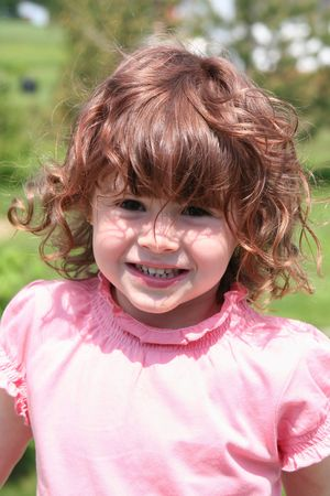 generration: Little Girl taken closeup with red hair