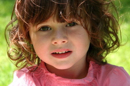 generration: Little Girl in outdoors in the grass