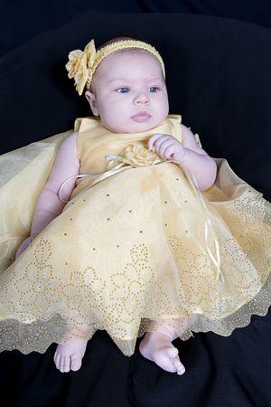 Little Baby Girl in yellow dress Фото со стока