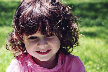 generration: Little girl outside looking away from camera