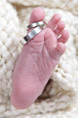 baby's mond genomen closeup met twee ringen Stockfoto