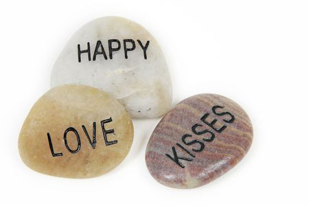 Love word engraved on stone with white background Stock Photo - 4987239
