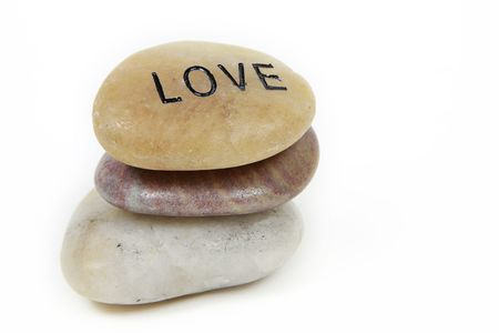 Love word engraved on stone with white background Stock Photo - 4987235