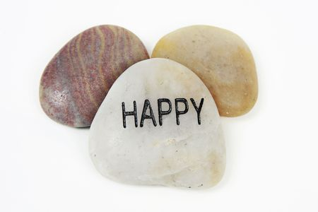 Happy word engraved on stone with white background Stock Photo - 4987236