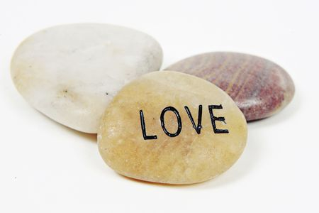 Love word engraved on stone with white background Stock Photo - 4987234