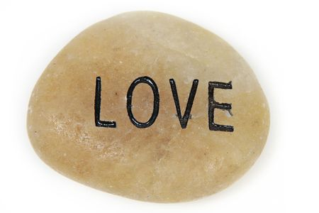 Love word engraved on stone with white background Stock Photo - 4987241