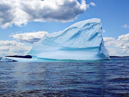 Iceberg in Ocean of Newfoundland                Фото со стока