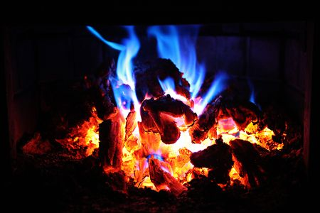 blue flame: Fire in Fireplace with red and blue flames Stock Photo