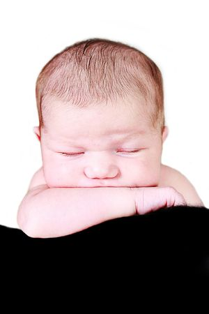 Little Baby Girl on sleeping with hand under chin Stock Photo