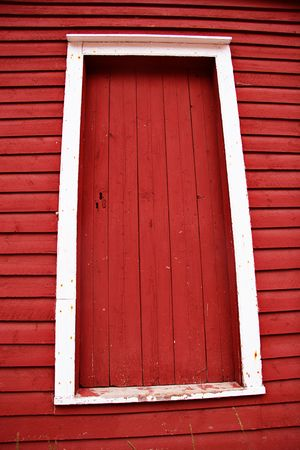 Old Red barn door with white trim photo